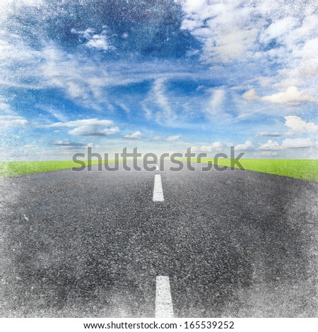 asphalted highway over blue sky with white clouds, grunge background