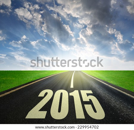 Asphalted road at sunset .Forward to the New Year 2015  - stock photo