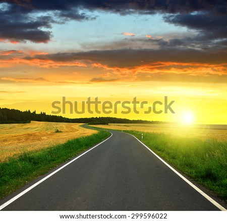 Asphalted road in the sunset