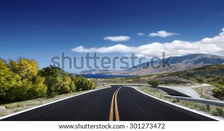 Asphalted road on a clear sunny day - stock photo
