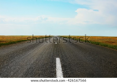 asphalted road sent to distance to horizon
