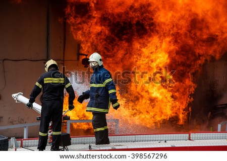 Aspropirgos, Greece - March 28, 2016: Firefighters struggle to extinguish the fire that broke out at a paint factory