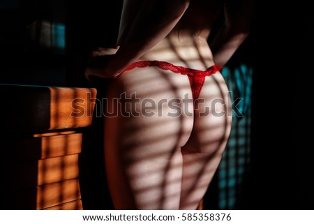 Ass beautiful girl in the room with side lighting