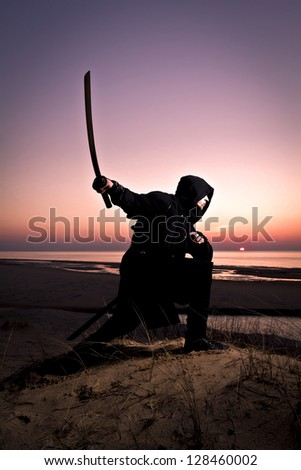 assassin at the sea - stock photo
