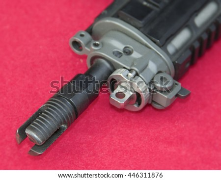Assault rifle on the red background - stock photo