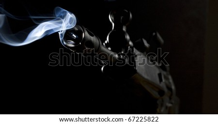 assault rifle that has just taken a shot in the dark - stock photo