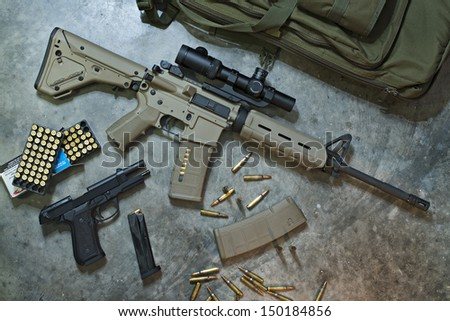 Assault Rifle with Pistol and Ammo - stock photo