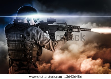 assault soldier with rifle on apocalyptic clouds, firing - stock photo