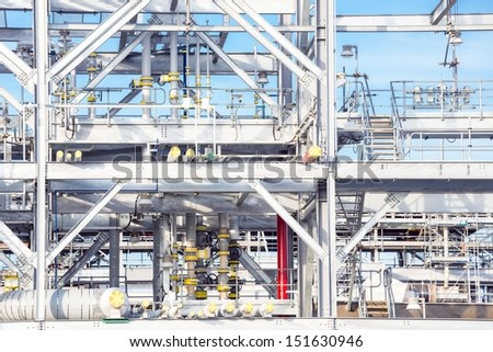Assembling of liquefied natural gas Refinery Factory with LNG storage tank using for Oil and gas industry background - stock photo