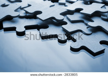 Assembling the puzzle piece by piece - stock photo