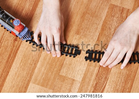 Assembling the railway. Connect rails. - stock photo