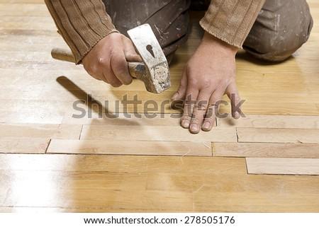 Assembling Wooden Floor - stock photo