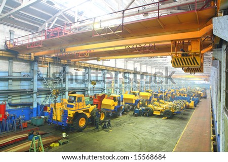 Assembly line: giant size industrial truck - stock photo