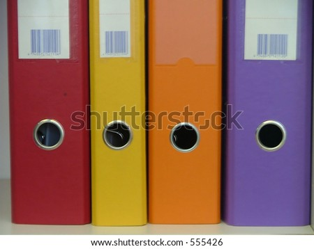 assembly of colorful file folders - stock photo