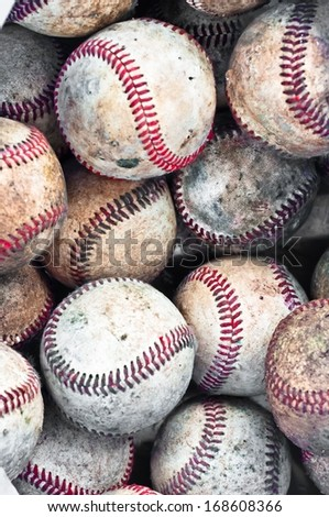 Assembly of many vintage white baseballs with red seams - stock photo