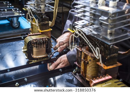 assembly welding machine on the assembly line, the installation of the transformer - stock photo