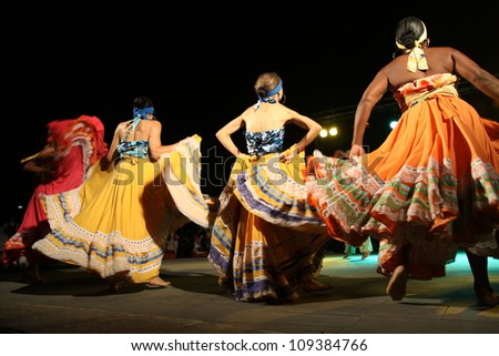 ASSEMINI, SARDINIA - AUGUST 1: A folklore dancing group from Columbia, performs during the International Folk Festival Is Pariglias 2012, on August 1, 2012 in Assemini, Sardinia.