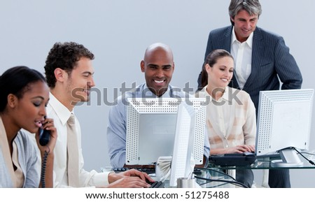 Assertive business team working in the office in a company - stock photo