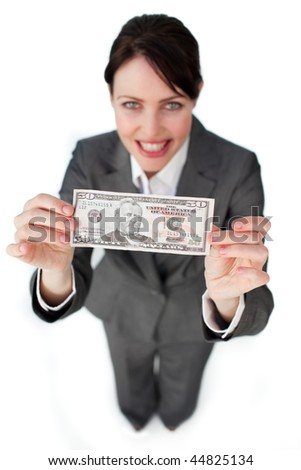 Assertive businesswoman showing a bank note against a white background - stock photo