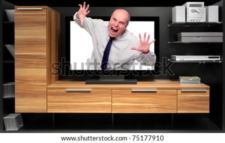 Assertive dealer attacking from tv screen on a furniture. - stock photo