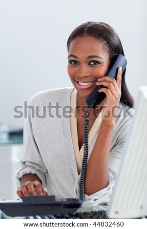 Assertive ethnic businesswoman on phone looking at the camera. Business concept.