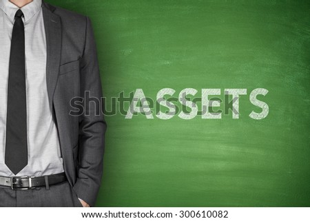 Assets text on green blackboard with businessman - stock photo