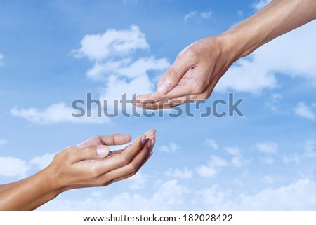 Assistance concept with helping hand on blue sky