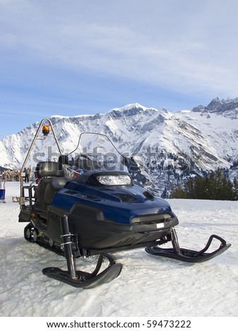 Assistance/Rescue Snowmobile in Elm Ski resort, Switzerland - stock photo