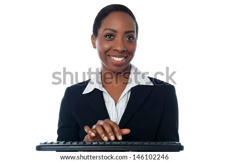 Assistant typing on computer keyboard - stock photo