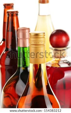 Assorted alcoholic beverages isolated on white background - stock photo