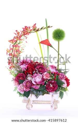 Assorted Artificial Flower Bouquet in multiple Color of Red Orange and many kind of flowers in Studio Lighting on White Background Powder puff lily - stock photo
