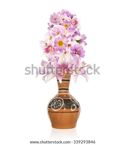 Assorted beautiful pink flower in old vintage ceramic vase.Lily,orchid,chamomile and other flowers - stock photo