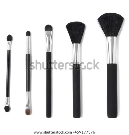 Assorted black and silver make up brushes isolated on a white background