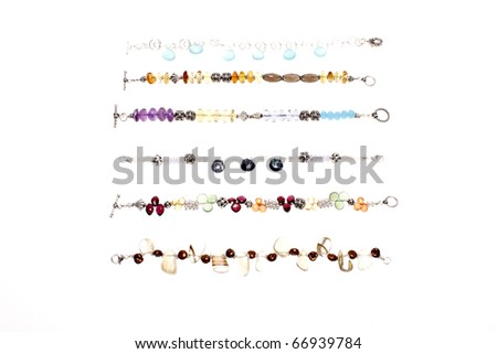 Assorted bracelets consisting of semiprecious stones and silver. - stock photo