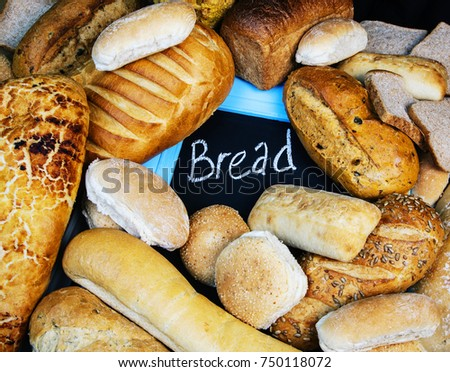 Assorted Bread Loaves And Different Types Of Bakery With Sign