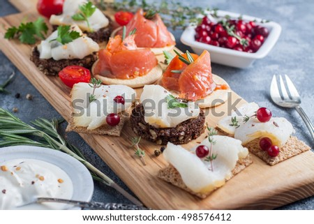 Assorted canape fresh smoked fish on board