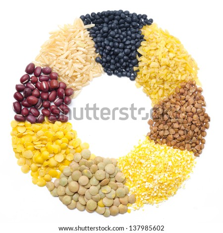 assorted cereals and legumes in form of a circle and space for text isolated on white - stock photo