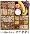 assorted cereals in wooden box with milk and fruits (manual focus) - stock photo