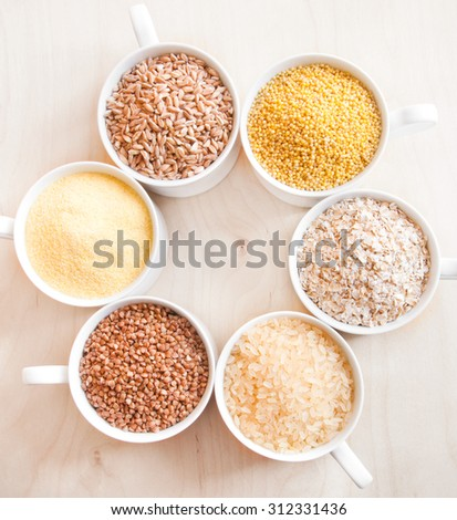Assorted cereals: oats, millet, rice, buckwheat, wheat, spelt - stock photo