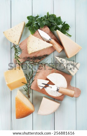 Assorted cheese on wooden table, rich and healthy snack or breakfast - stock photo