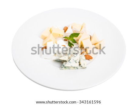 Assorted cheese platter with almonds and mint. Isolated on a white background. - stock photo