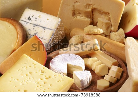 Assorted cheeses in various shapes and sizes - stock photo
