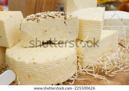 Assorted cheeses on the table - stock photo