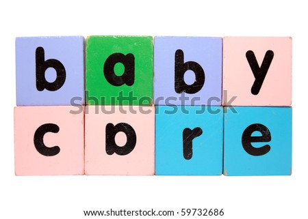 assorted children's toy letter building blocks against a white background that spell baby care with clipping path - stock photo