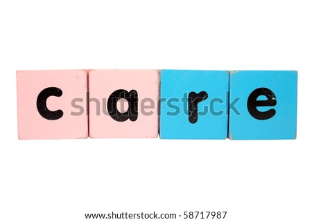 assorted childrens toy letter building blocks against a white background that spell care with clipping path - stock photo