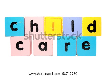 assorted childrens toy letter building blocks against a white background that spell childcare with clipping path