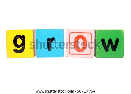 assorted childrens toy letter building blocks against a white background that spell grow with clipping path - stock photo