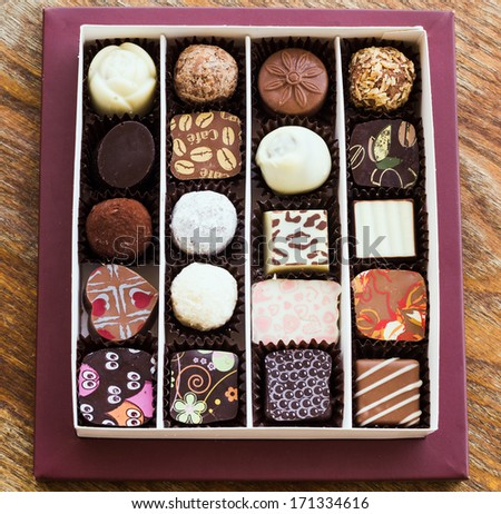 Assorted chocolate candies on a wooden table