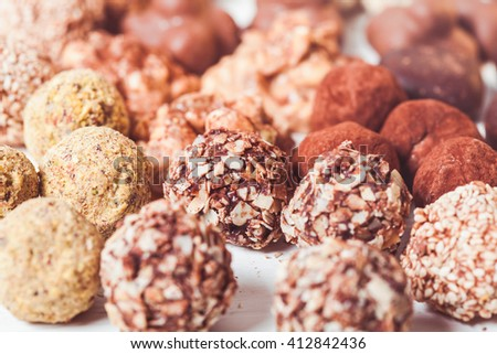 Assorted Chocolate candies on the white table. Luxury handmade sweets - stock photo