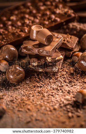 Assorted chocolate pralines and bars background - stock photo